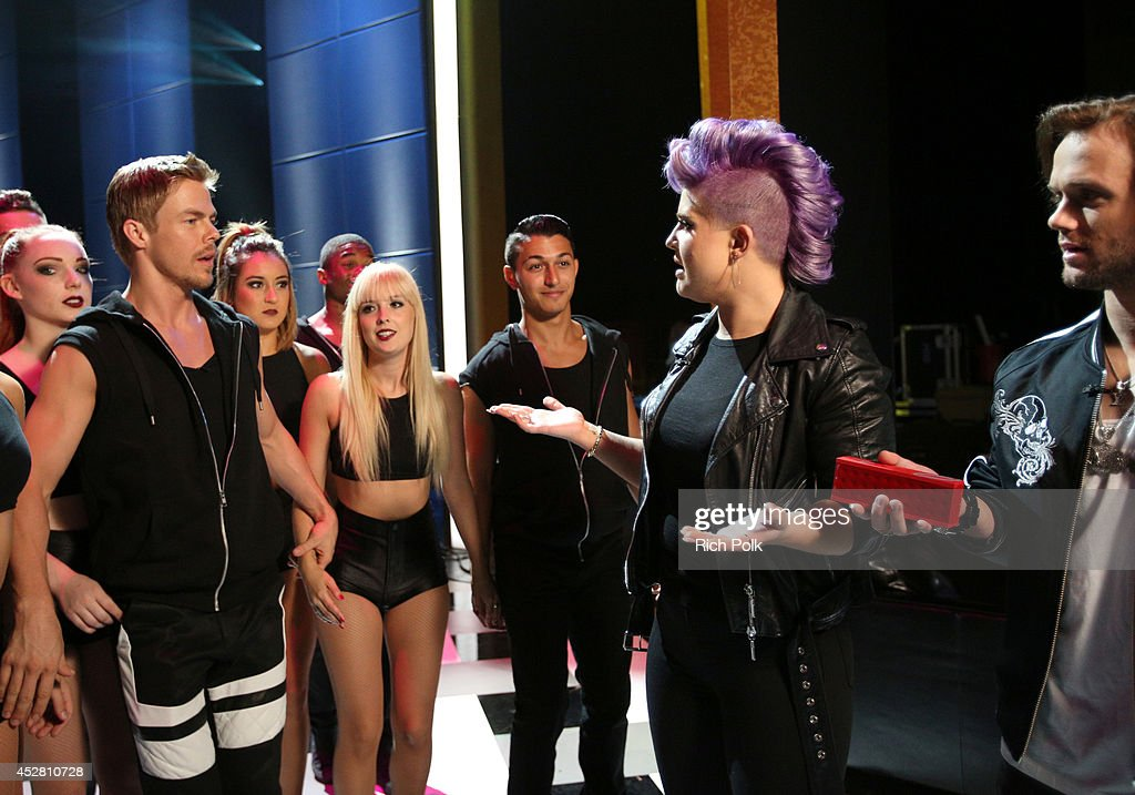 TV Personality Derek Hough host Kelly Osbourne and professional snowboarder Louie Vito backstage at the 2014 Young Hollywood Awards brought to you by...