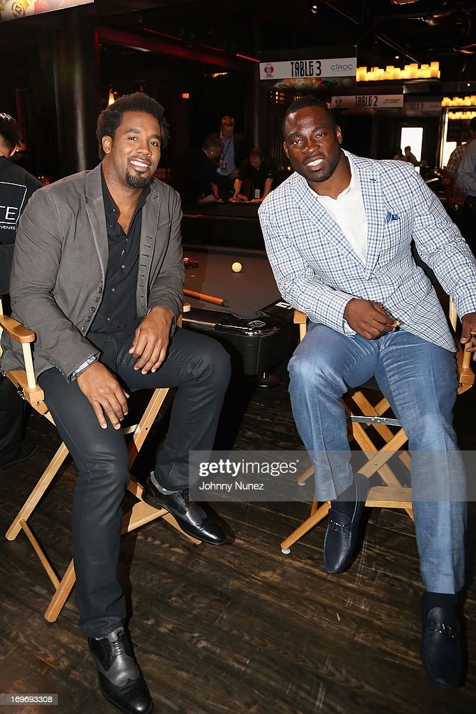 TV Personality Dhani Jones and NY Giants Justin Tuck attend the NY Giants Justin Tuck's 5th Annual Celebrity Billiards Tournament on May 30, 2013 in New York City.