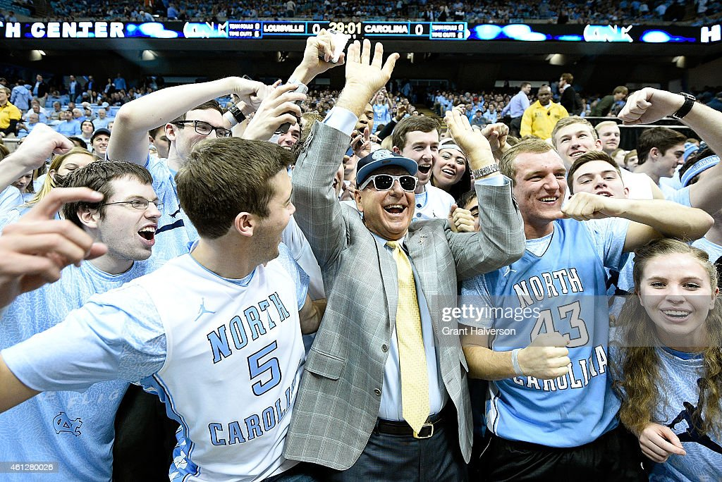 ESPN personality <a gi-track='captionPersonalityLinkClicked' href=/galleries/search?phrase=Dick+Vitale&family=editorial&specificpeople=730924 ng-click='$event.stopPropagation()'>Dick Vitale</a> spends time in the student section before the game between the North Carolina Tar Heels and the Louisville Cardinals at the Dean Smith Center on January 10, 2015 in Chapel Hill, North Carolina.