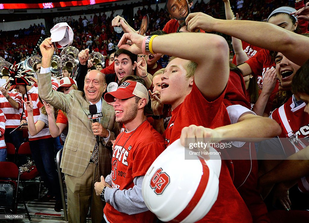 ESPN personality <a gi-track='captionPersonalityLinkClicked' href=/galleries/search?phrase=Dick+Vitale&family=editorial&specificpeople=730924 ng-click='$event.stopPropagation()'>Dick Vitale</a> wades into the crowd for photos before a game between the North Carolina Tar Heels and the North Carolina State Wolfpack during play at PNC Arena on January 26, 2013 in Raleigh, North Carolina.