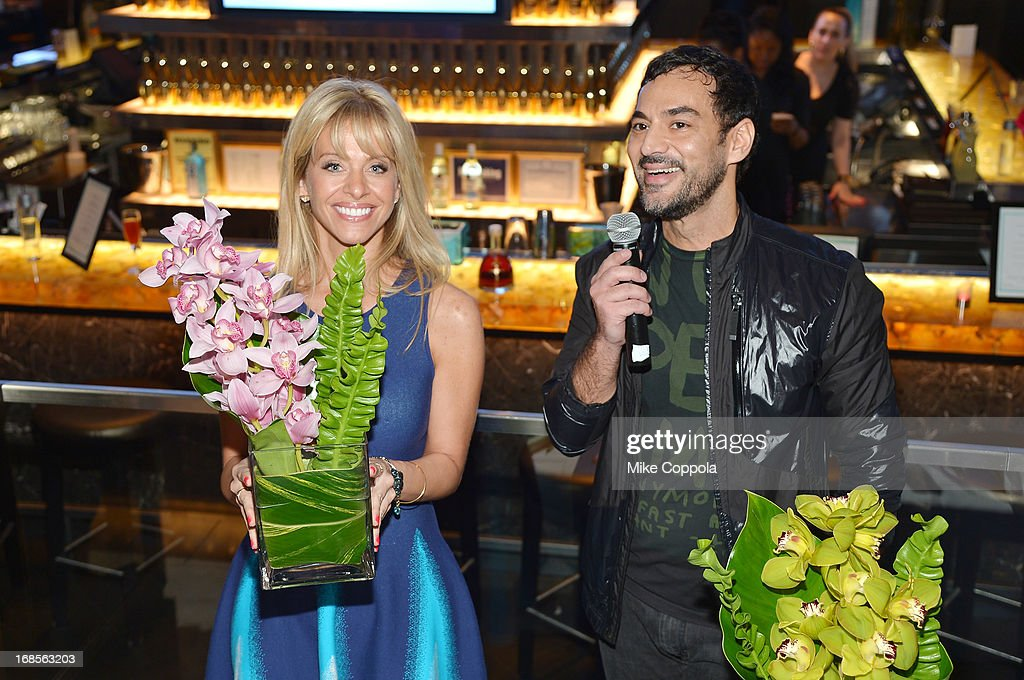 TV personality <a gi-track='captionPersonalityLinkClicked' href=/galleries/search?phrase=Dina+Manzo&family=editorial&specificpeople=5841104 ng-click='$event.stopPropagation()'>Dina Manzo</a> and floral artist Oscar Mora present at the Shawn Carter Foundation's Mother's Day event 'Celebrating Mothers, Our First Educators' at 40 / 40 Club on May 11, 2013 in New York City.