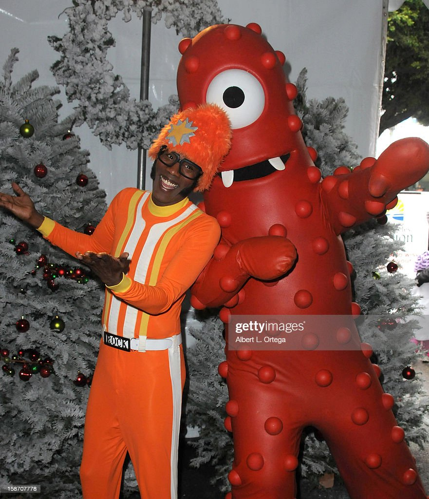 Personality DJ Lance Rock and Muno participate in the Los Angeles Mission Christmas Eve lunch For The Homeless held at the Los Angeles Mission on December 24, 2012 in Los Angeles, California.