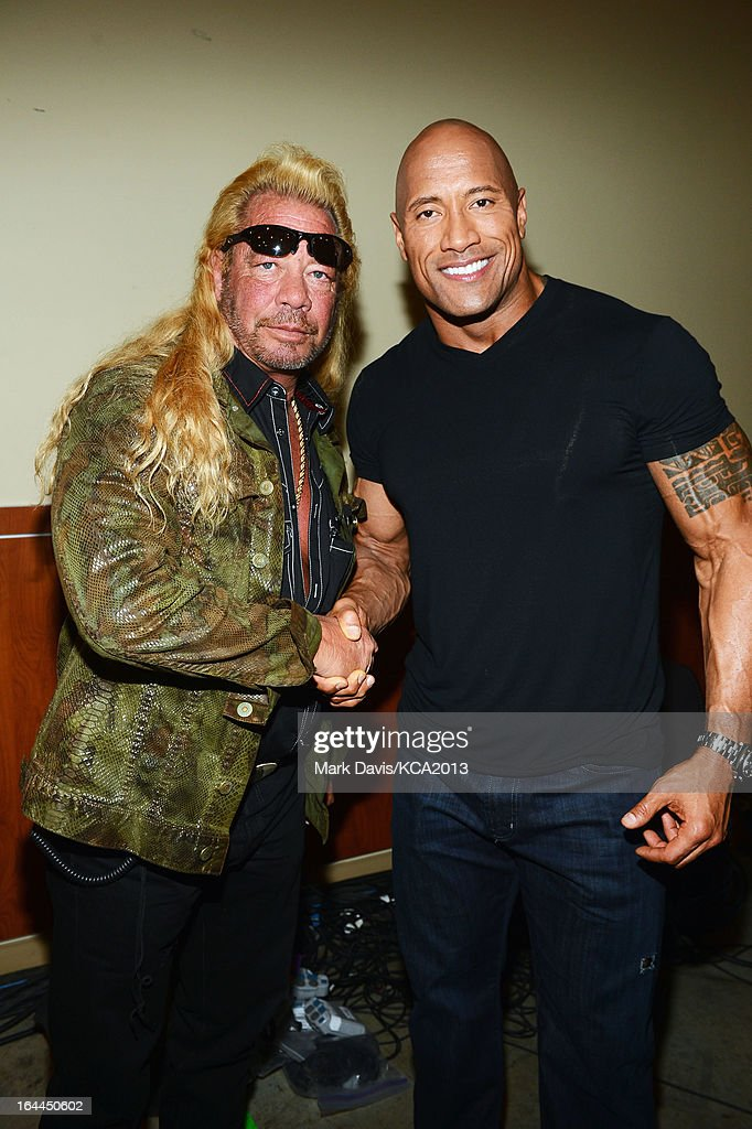 TV personality Dog the Bounty Hunter (L) and actor <a gi-track='captionPersonalityLinkClicked' href=/galleries/search?phrase=Dwayne+Johnson&family=editorial&specificpeople=210704 ng-click='$event.stopPropagation()'>Dwayne Johnson</a> pose backstage at Nickelodeon's 26th Annual Kids' Choice Awards at USC Galen Center on March 23, 2013 in Los Angeles, California.
