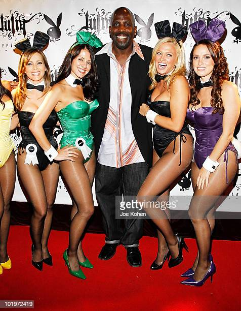 TV personality Dot Com poses for a photo with playboy bunnies Deanna Brooks Pennelope Jimenez Laurie Fetter and Lindsey Vuolo at the Playboy's 50th...