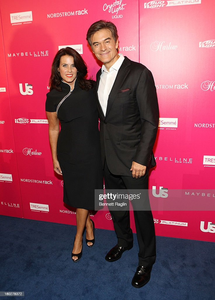TV personality Dr. Mehmet Oz (R) and Lisa Oz attend the Us Weekly's Most Stylish New Yorkers Party at Harlow on September 10, 2013 in New York City.