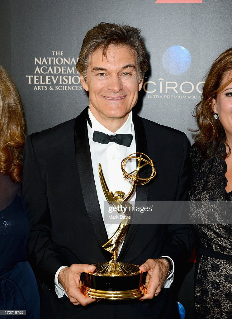 TV personality Dr. <a gi-track='captionPersonalityLinkClicked' href=/galleries/search?phrase=Mehmet+Oz&family=editorial&specificpeople=4175862 ng-click='$event.stopPropagation()'>Mehmet Oz</a> poses with the Outstanding Talk Show Informative award for 'The Dr. Oz Show' in the press room during The 40th Annual Daytime Emmy Awards at The Beverly Hilton Hotel on June 16, 2013 in Beverly Hills, California.
