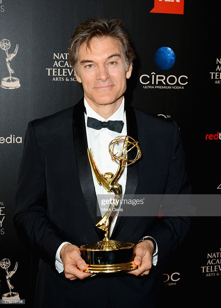 TV personality Dr. Mehmet Oz poses with the Outstanding Talk Show Informative award for 'The Dr. Oz Show' in the press room during The 40th Annual Daytime Emmy Awards at The Beverly Hilton Hotel on June 16, 2013 in Beverly Hills, California.