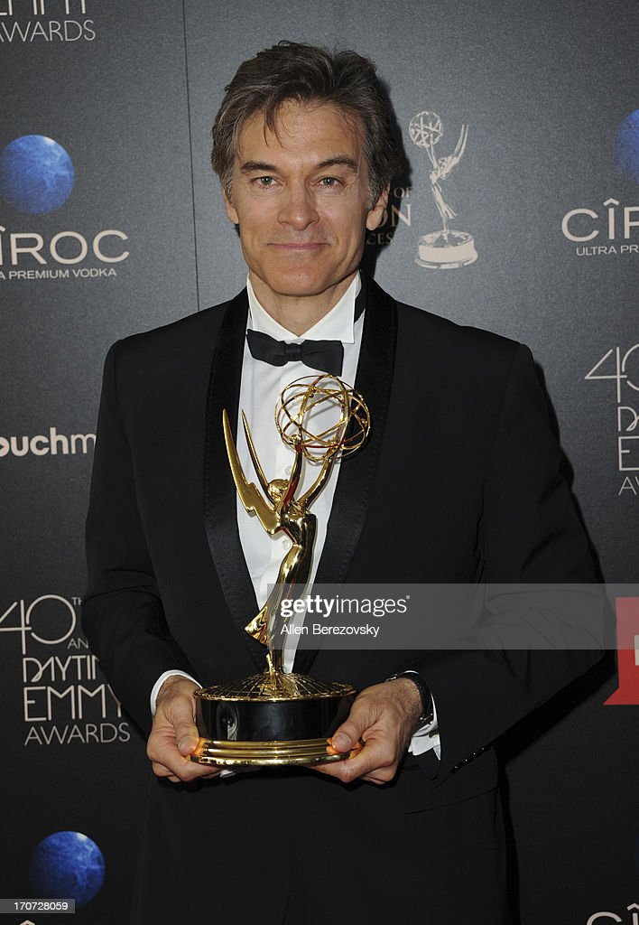 TV personality Dr. Mehmet Oz poses with the Outstanding Talk Show Informative award for 'The Dr. Oz Show' at 40th Annual Daytime Entertaimment Emmy Awards at The Beverly Hilton Hotel on June 16, 2013 in Beverly Hills, California.