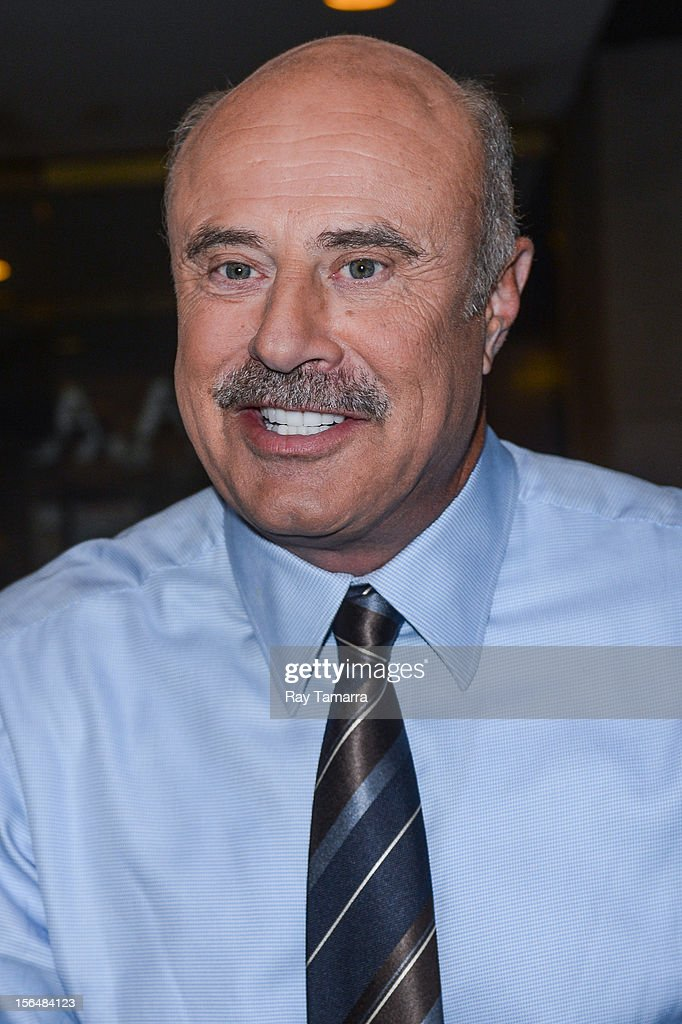TV personality Dr. <a gi-track='captionPersonalityLinkClicked' href=/galleries/search?phrase=Phil+McGraw&family=editorial&specificpeople=234933 ng-click='$event.stopPropagation()'>Phil McGraw</a> leaves the 'Today Show' taping at the NBC Rockefeller Center Studios on November 15, 2012 in New York City.