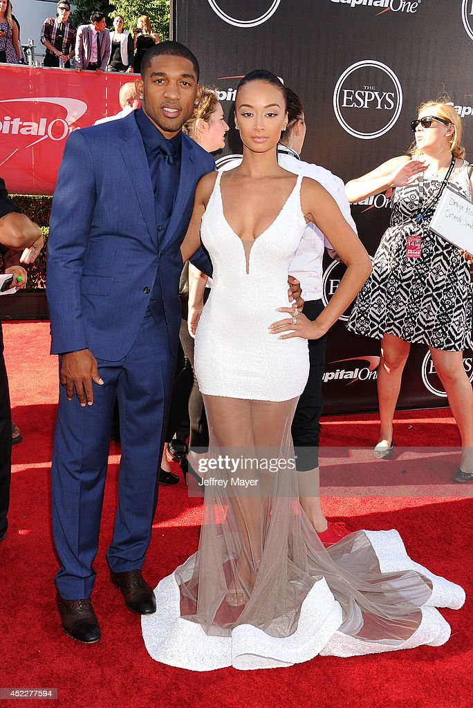 TV personality <a gi-track='captionPersonalityLinkClicked' href=/galleries/search?phrase=Draya+Michele&family=editorial&specificpeople=8019170 ng-click='$event.stopPropagation()'>Draya Michele</a> (R) and NFL player <a gi-track='captionPersonalityLinkClicked' href=/galleries/search?phrase=Orlando+Scandrick&family=editorial&specificpeople=4489435 ng-click='$event.stopPropagation()'>Orlando Scandrick</a> arrive at the 2014 ESPY Awards at Nokia Theatre L.A. Live on July 16, 2014 in Los Angeles, California.