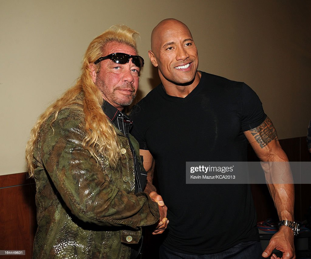 TV personality Duane 'Dog' Chapman (L) and actor Dwayne Johnson attend Nickelodeon's 26th Annual Kids' Choice Awards at USC Galen Center on March 23, 2013 in Los Angeles, California.