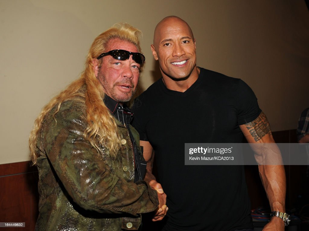 TV personality Duane 'Dog' Chapman (L) and actor <a gi-track='captionPersonalityLinkClicked' href=/galleries/search?phrase=Dwayne+Johnson&family=editorial&specificpeople=210704 ng-click='$event.stopPropagation()'>Dwayne Johnson</a> attend Nickelodeon's 26th Annual Kids' Choice Awards at USC Galen Center on March 23, 2013 in Los Angeles, California.