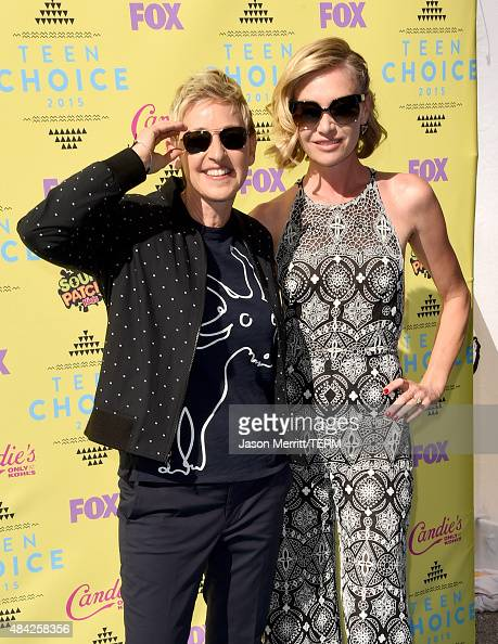 TV personality Ellen DeGeneres and actress Portia de Rossi attend the Teen Choice Awards 2015 at the USC Galen Center on August 16 2015 in Los...