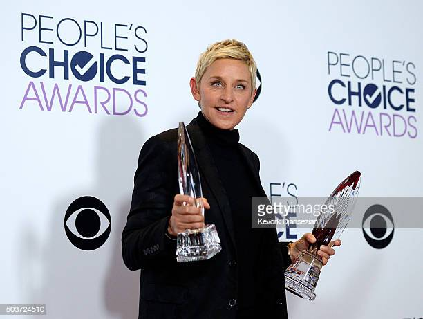 TV personality Ellen DeGeneres poses with two People's Choice Awards backstage on January 6 in Los Angeles California