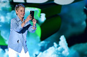TV personality Ellen DeGeneres takes a photograph while speaking onstage during Nickelodeon's 2016 Kids' Choice Awards at The Forum on March 12 2016...