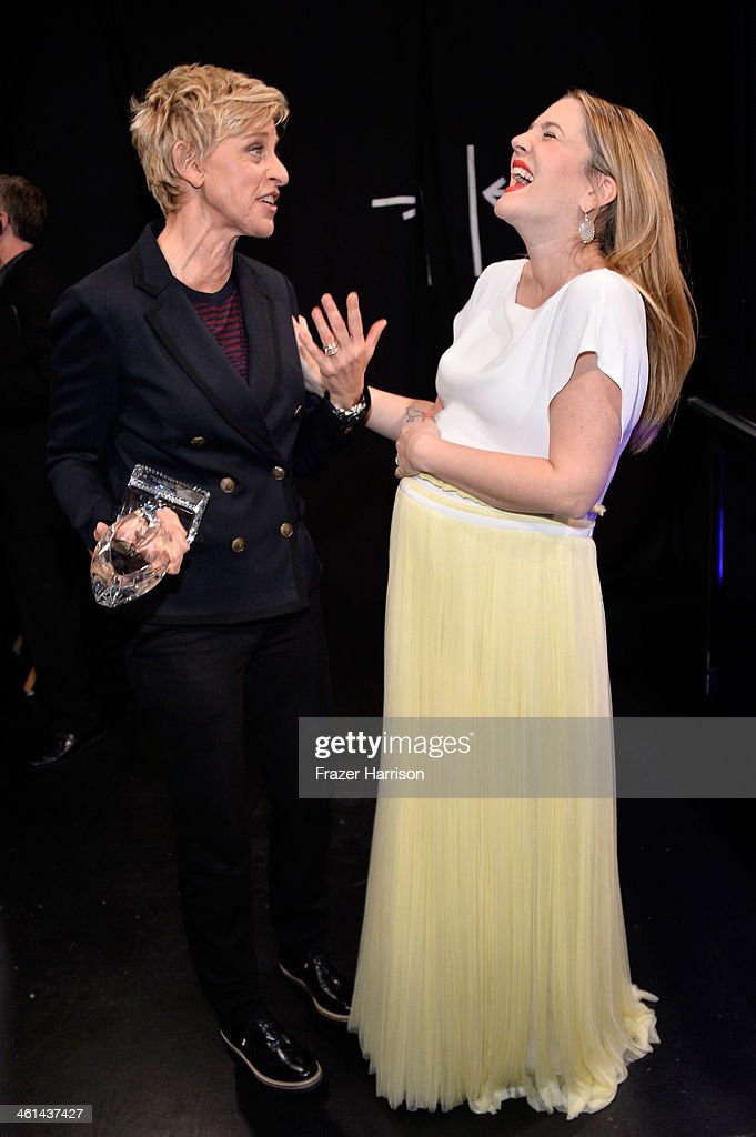 TV personality Ellen DeGeneres (L), winner of the Favorite Daytime TV Host award, and actress Drew Barrymore attend The 40th Annual People's Choice Awards at Nokia Theatre L.A. Live on January 8, 2014 in Los Angeles, California.