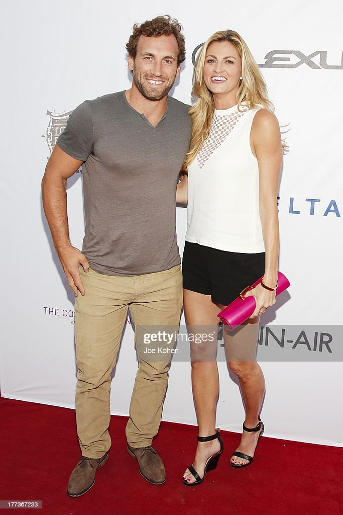 TV personality Erin Andrews (R) and professional ice hockey player Jarret Stoll attend the 2013 Los Angeles Food & Wine Festival 'Festa Italiana With Giada De Laurentiis' Opening Night Gala on August 22, 2013 in Los Angeles, California.