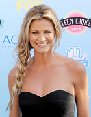 TV personality Erin Andrews arrives at the 2013 Teen Choice Awards at Gibson Amphitheatre on August 11 2013 in Universal City California