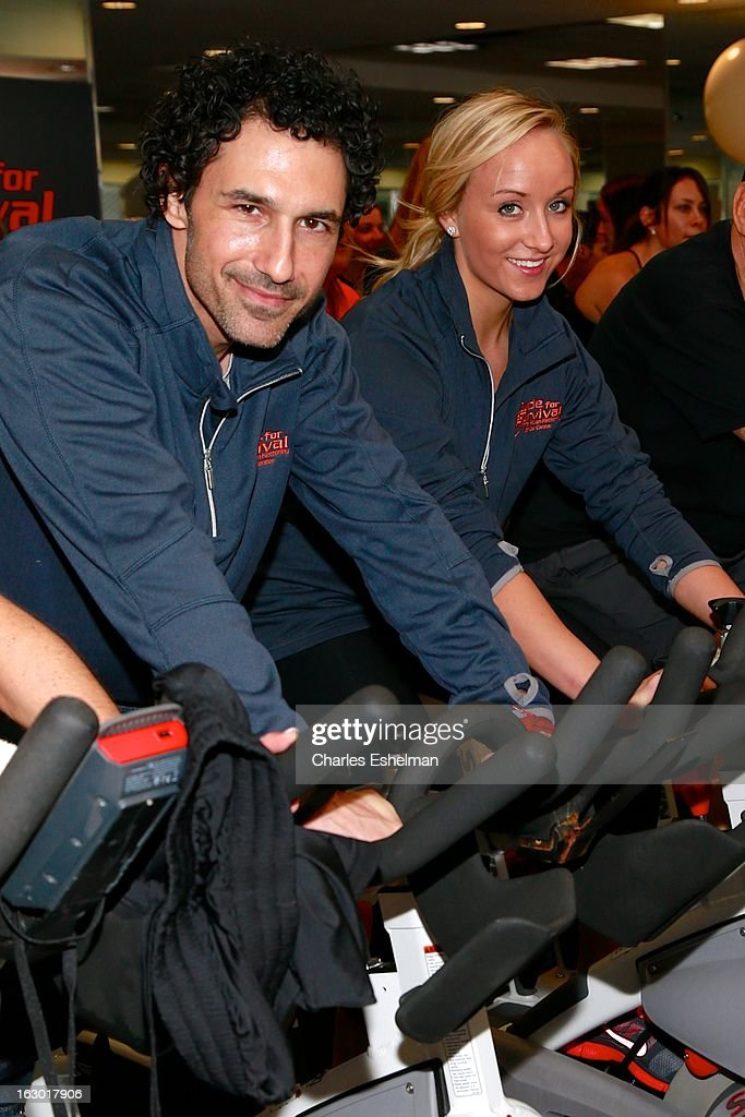 TV personality <a gi-track='captionPersonalityLinkClicked' href=/galleries/search?phrase=Ethan+Zohn&family=editorial&specificpeople=215204 ng-click='$event.stopPropagation()'>Ethan Zohn</a> and gymnast <a gi-track='captionPersonalityLinkClicked' href=/galleries/search?phrase=Nastia+Liukin&family=editorial&specificpeople=241334 ng-click='$event.stopPropagation()'>Nastia Liukin</a> spin at the 2013 Cycle For Survival Benefit at Equinox Rock Center on March 3, 2013 in New York City.