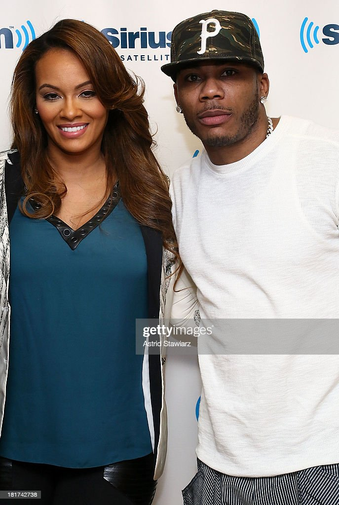 TV personality Evelyn Lozada and rapper Nelly visit the SiriusXM Studios on September 24, 2013 in New York City.