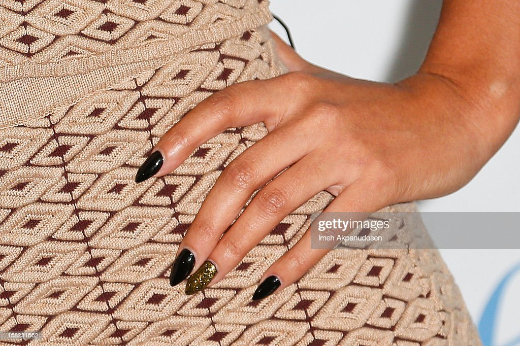 TV personality Evelyn Lozada (nail polish detail) unveils her 'Cheeky' new winter-themed naked anti-fur ad for PETA held at the at The Bob Barker Building on December 11, 2012 in Los Angeles, California.