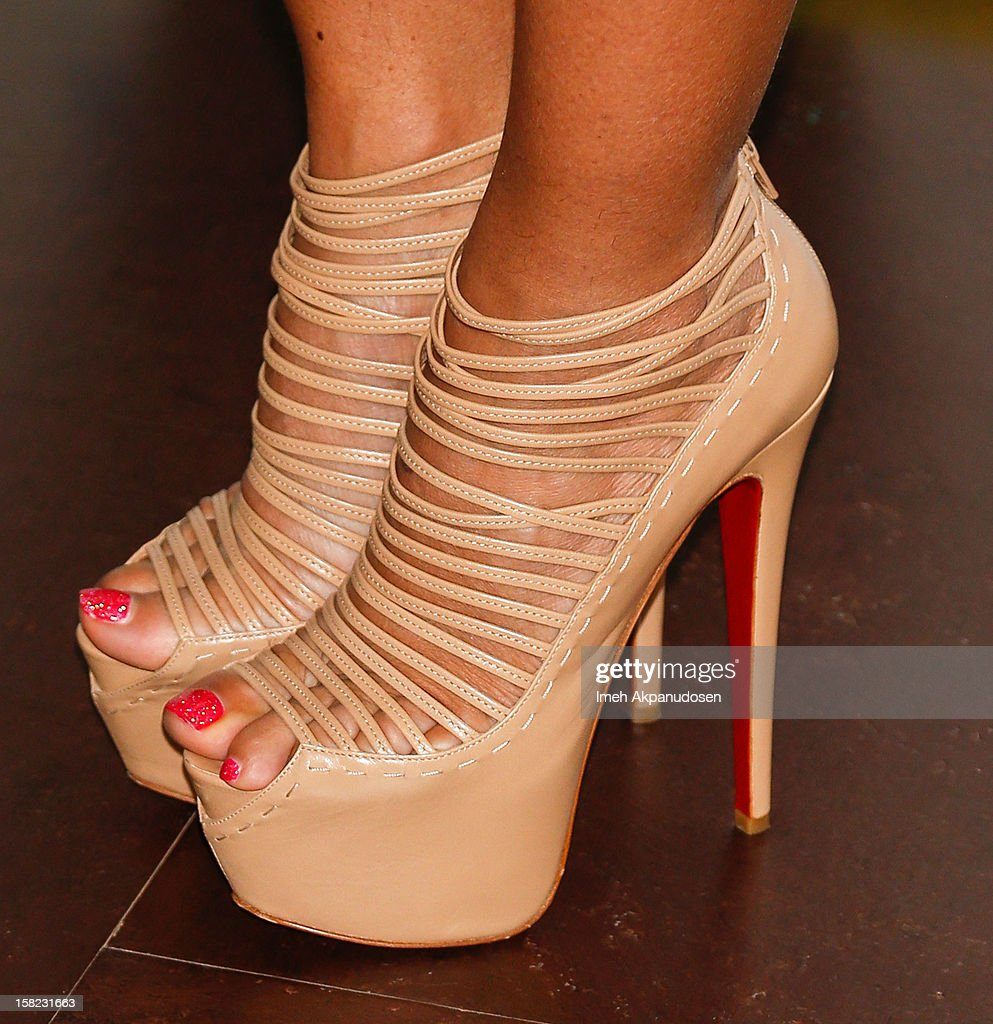 TV personality <a gi-track='captionPersonalityLinkClicked' href=/galleries/search?phrase=Evelyn+Lozada&family=editorial&specificpeople=6747068 ng-click='$event.stopPropagation()'>Evelyn Lozada</a> (shoe detail) unveils her 'Cheeky' new winter-themed naked anti-fur ad for PETA held at the at The Bob Barker Building on December 11, 2012 in Los Angeles, California.