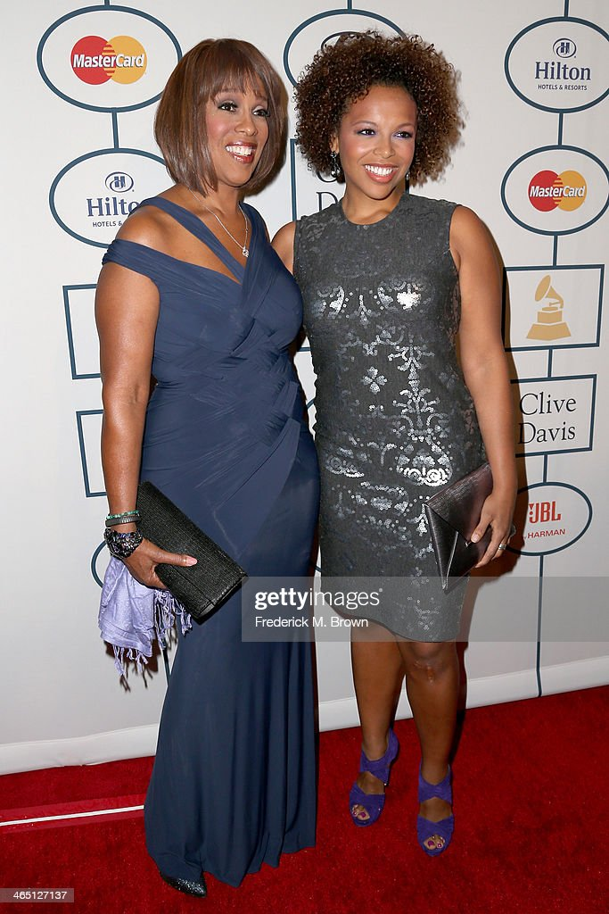 TV personality Gayle King and guest attends the 56th annual GRAMMY Awards Pre-GRAMMY Gala and Salute to Industry Icons honoring Lucian Grainge at The Beverly Hilton on January 25, 2014 in Beverly Hills, California.