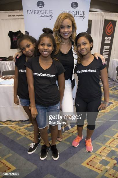 TV personality Gizelle Bryant and her daughters attend Day 2 of the '2017 Ubiquitous Beauty Hair Health Expo' at Walter E Washington Convention...