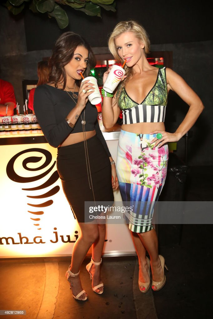 TV personality Golnesa 'GG' Gharachedaghi (L) and model/TV personality Joanna Krupa attend OK Magazine's So Sexy L.A. Event at LURE on May 21, 2014 in Los Angeles, California.