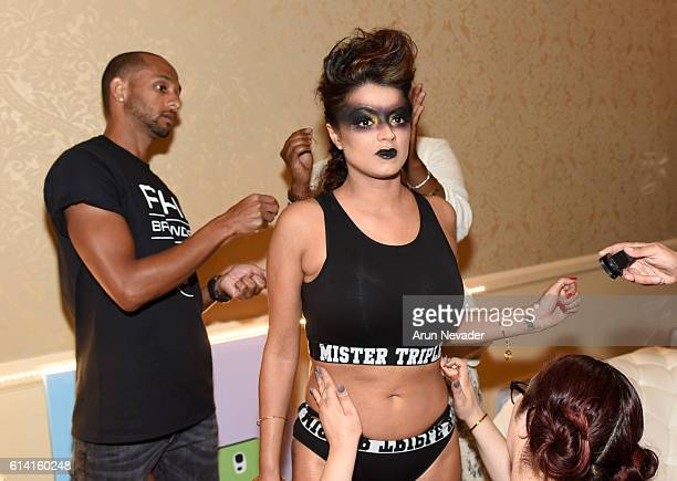 V personality Golnesa 'GG' Gharachedaghi gets ready backstage at Art Hearts Fashion Los Angeles Fashion Week on October 11 2016 in Los Angeles...
