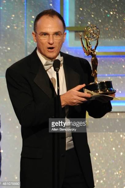 TV personality Guillermo Arduino accepts an Emmy Award for Outstanding Entertainment Program in Spanish for 'Clix' onstage during the 41st Annual...