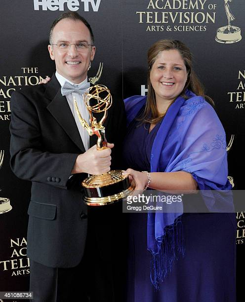 TV personality Guillermo Arduino and producer Magdalena Cabral pose in the press room at the 41st Annual Daytime Emmy Awards at The Beverly Hilton...
