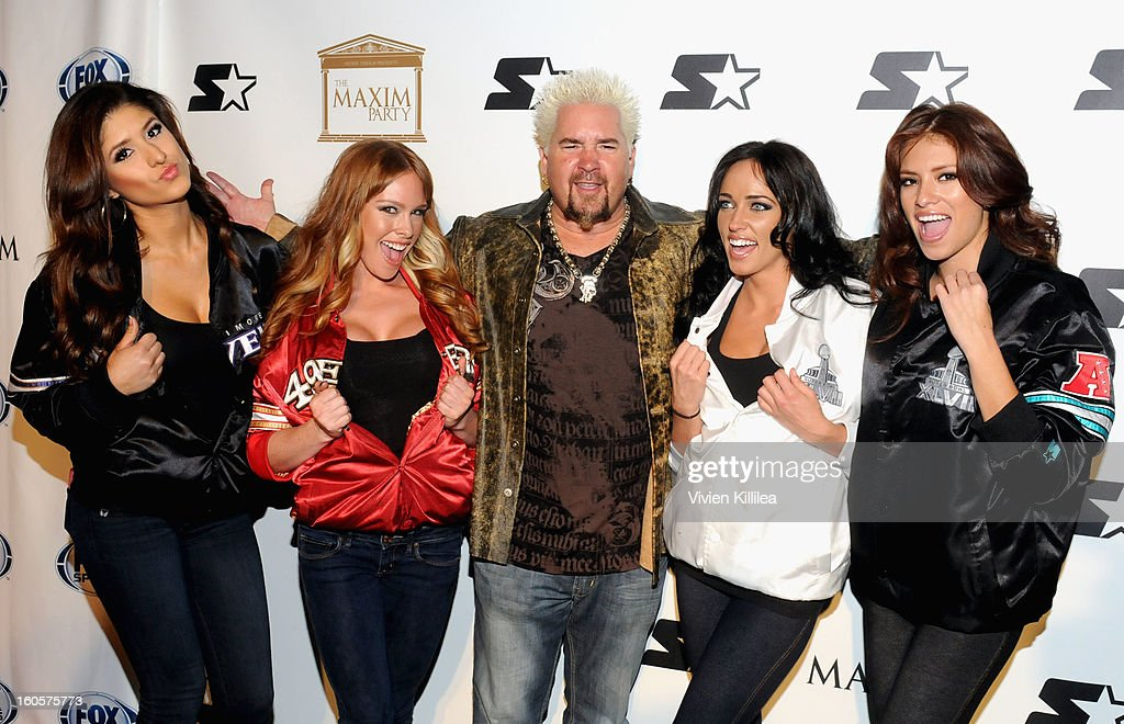 TV personality <a gi-track='captionPersonalityLinkClicked' href=/galleries/search?phrase=Guy+Fieri&family=editorial&specificpeople=4593795 ng-click='$event.stopPropagation()'>Guy Fieri</a> (C) poses on the Starter Red Carpet at the Maxim Party during Super Bowl XLVII at Second Line Warehouse on February 2, 2013 in New Orleans, Louisiana.