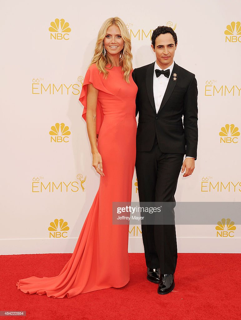 TV personality Heidi Klum and fashion designer Zac Posen arrive at the 66th Annual Primetime Emmy Awards at Nokia Theatre LA Live on August 25 2014...