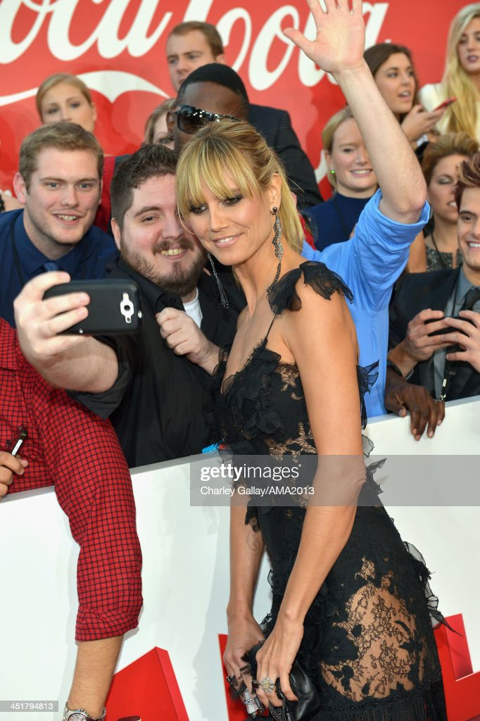 TV personality <a gi-track='captionPersonalityLinkClicked' href=/galleries/search?phrase=Heidi+Klum&family=editorial&specificpeople=178954 ng-click='$event.stopPropagation()'>Heidi Klum</a> attends the 2013 American Music Awards Powered by Dodge at Nokia Theatre L.A. Live on November 24, 2013 in Los Angeles, California.