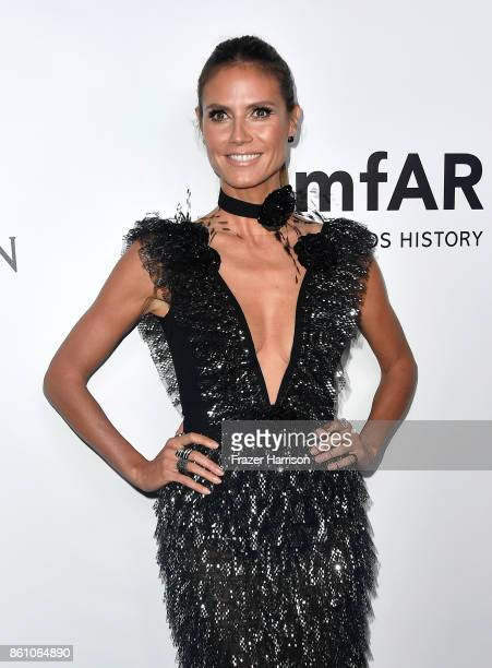 TV personality Heidi Klum attends the amfAR Gala Los Angeles 2017 at Ron Burkle's Green Acres Estate on October 13 2017 in Beverly Hills California