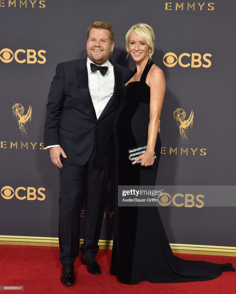 TV personality James Corden (L) and producer Julia Carey arrive at the 69th Annual Primetime Emmy Awards at Microsoft Theater on September 17, 2017 in Los Angeles, California.