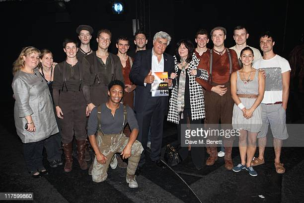 TV Personality Jay Leno and wife Mavis pose with the cast of the West End production of 'War Horse' at the New London Theatre on June 28 2011 in...