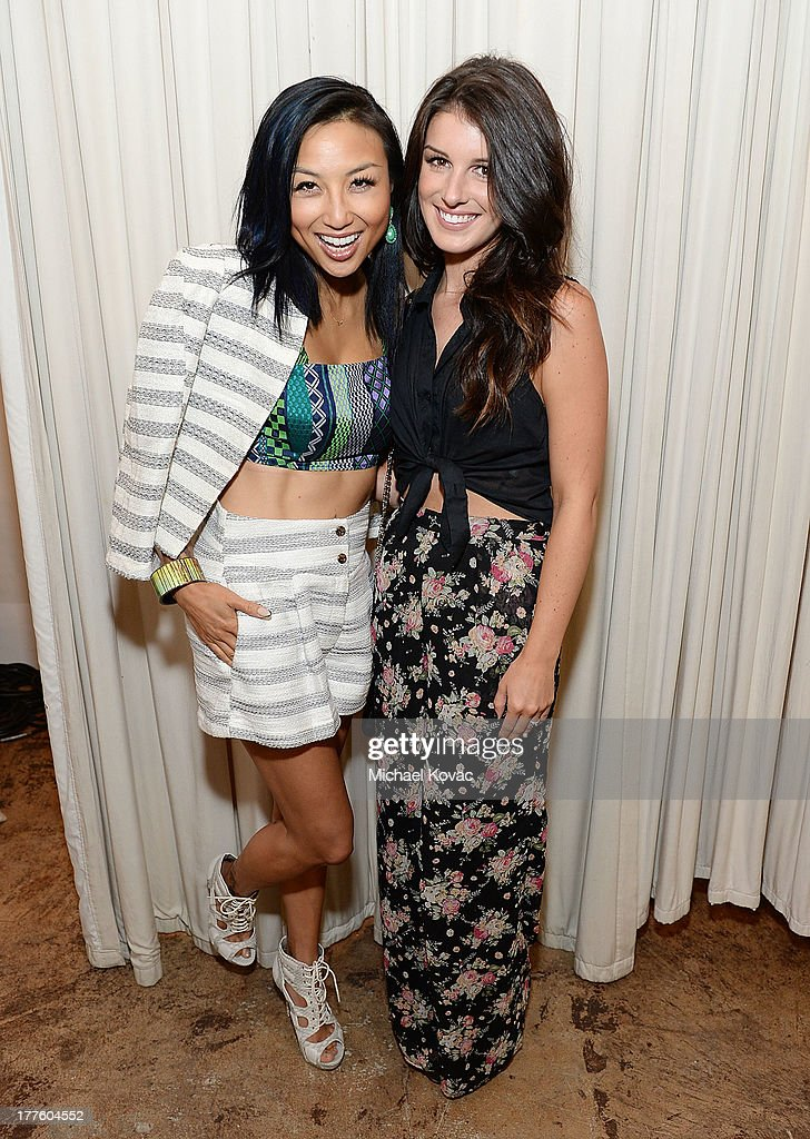TV personality Jeannie Mai (L) and actress Shenae Grimes attend BeautyCon LA, a fashion and beauty summit for the top digital influences online at Siren Studios on August 24, 2013 in Hollywood, California.