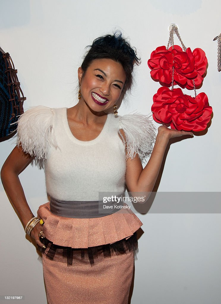 TV Personality Jeannie Mai showcases her pocket book at the OpenSky Pop-Up Gallery launch at 477 Broome Street on November 10, 2011 in New York City.