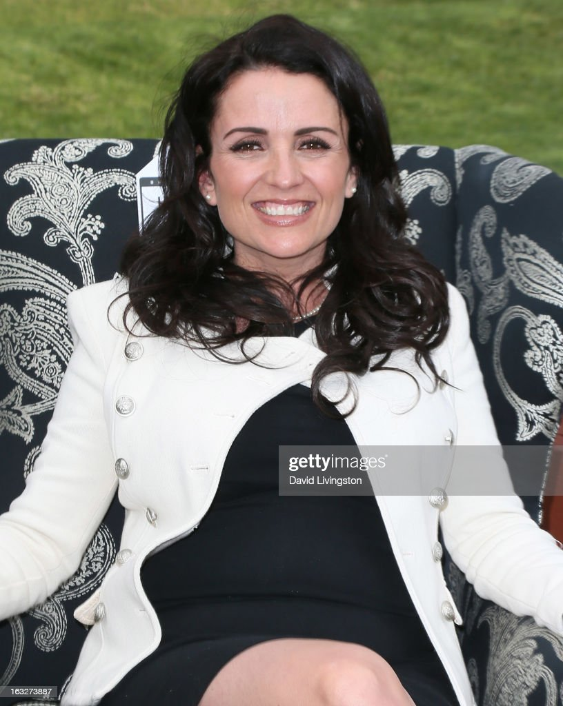 TV personality <a gi-track='captionPersonalityLinkClicked' href=/galleries/search?phrase=Jenni+Pulos&family=editorial&specificpeople=4406071 ng-click='$event.stopPropagation()'>Jenni Pulos</a> poses at the launch of House Beautiful Magazine's 'Chair Chase' on March 6, 2013 in Hollywood, California.