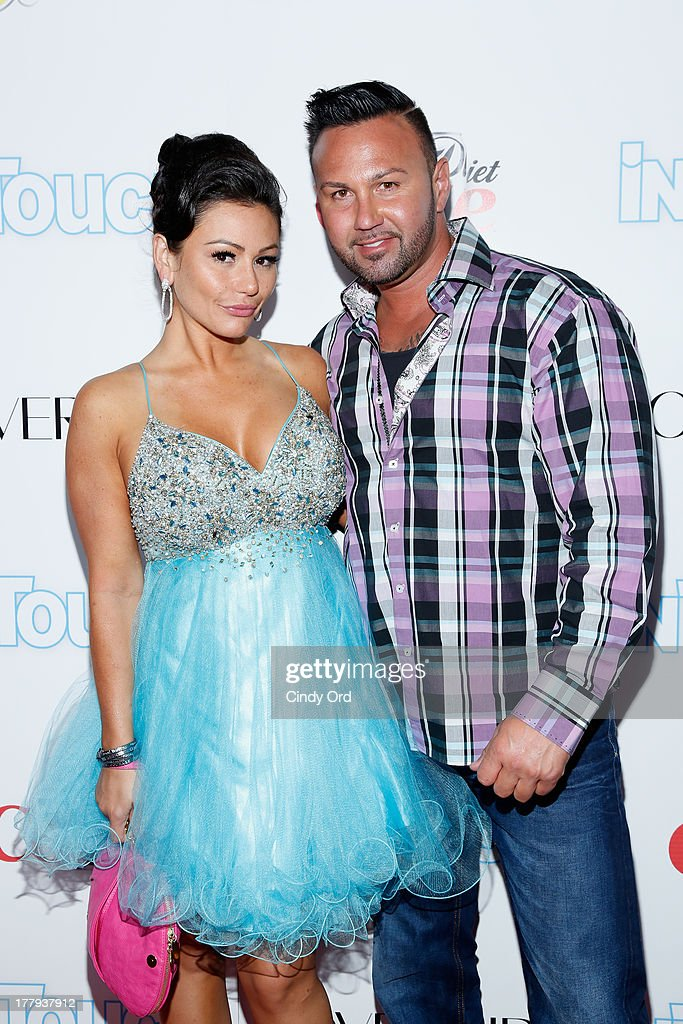 TV Personality Jennifer JWOWW Farley and Roger Mathews arrive at Intouch Weekly's 'ICONS & IDOLS Party' at FINALE Nightclub on August 25, 2013 in New York City.