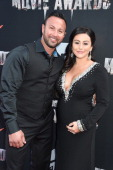 TV personality Jennifer 'JWoww' Farley and Roger Mathews attend the 2014 MTV Movie Awards at Nokia Theatre LA Live on April 13 2014 in Los Angeles...