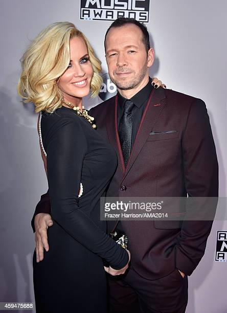 TV personality Jenny McCarthy and recording artist Donnie Wahlberg attend the 2014 American Music Awards at Nokia Theatre LA Live on November 23 2014...
