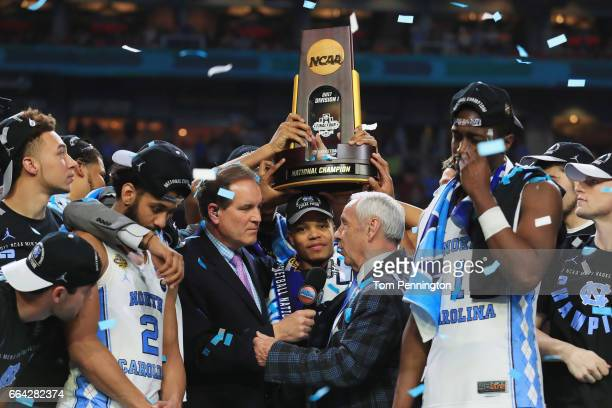 TV personality Jim Nantz speaks to head coach Roy Williams of the North Carolina Tar Heels and his team after defeating the Gonzaga Bulldogs during...