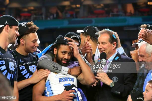 TV personality Jim Nantz speaks to Most Outstanding Player Joel Berry II of the North Carolina Tar Heels after defeating the Gonzaga Bulldogs during...