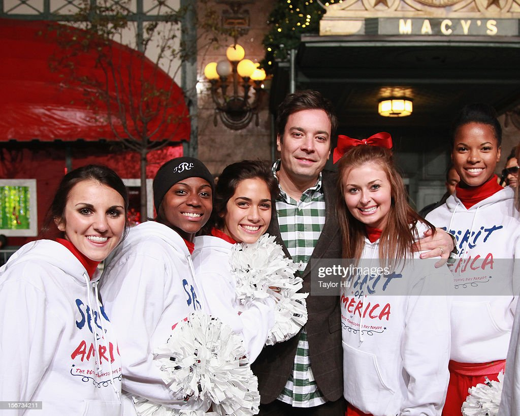 TV personality Jimmy Fallon poses with Spirit of America cheerleaders at Day One of the 86th Anniversary Macy's Thanksgiving Day Parade Rehearsals at Macy's Herald Square on November 19, 2012 in New York City.