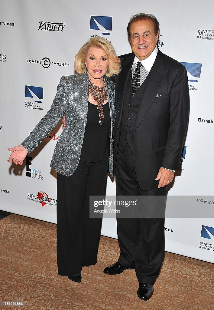 TV personality Joan Rivers and talent manager Larry Thompson attend the 12th Annual Heller Awards at The Beverly Hilton Hotel on September 19, 2013 in Beverly Hills, California.