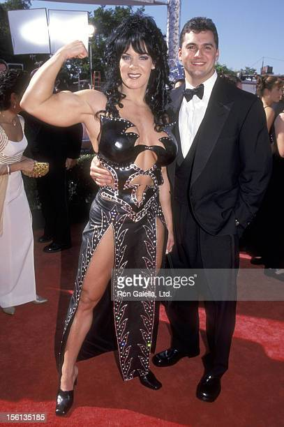 TV Personality Joanie Laurer and Businessman Shane McMahon attend the 51st Annual Primetime Emmy Awards on September 12 1999 at Shrine Auditorium in...
