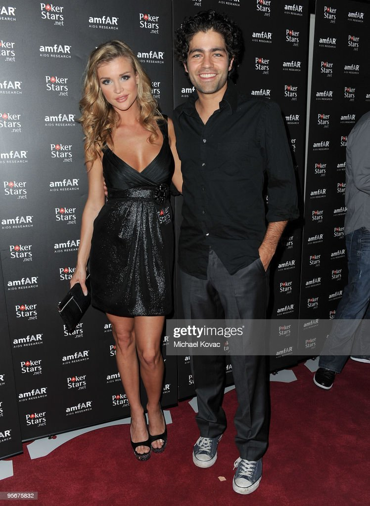 TV personality Joanna Krupa (L) and actor Adrian Grenier arrive at the amfAR Cocktail Party & PokerStars Red Carpet And Party at Aura Nightclub on January 9, 2010 in Nassau, Bahamas.